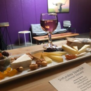 photo of cheese plate with a glass of wine