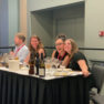 image of 4 people sitting on a panel at ACS